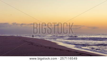 Sweet Sunrise On The Beach. Serenity Of A Person When Walking On The Sand By The Sea.