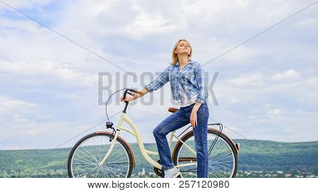Woman Rides Bicycle Sky Background. Reasons To Ride Bike. Benefits Of Cycling Every Day. Keep Fit Sh
