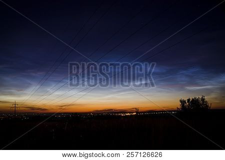 Night Landscape With Electric Line And Noctilucent Clouds