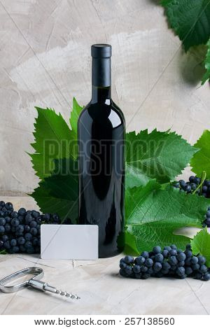 Bottle Of Red Wine Mockup For Your Logotype, White Paper Business Card For Text, Copy Space. Red Gra