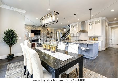Beautiful Kitchen In Luxury Modern Contemporary Home Interior With Island And Chairs