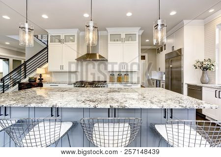 Beautiful Kitchen In Luxury Modern Home Interior With Island And Stainless Steel Chairs