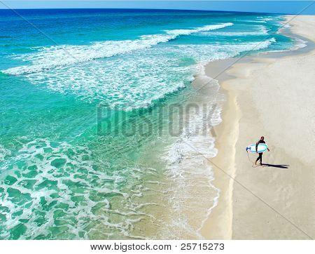 Surfer on Deserted Beach