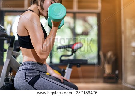 Woman Exercise Workout In Gym Fitness With Dumbbell; Healthy Lifestyle.