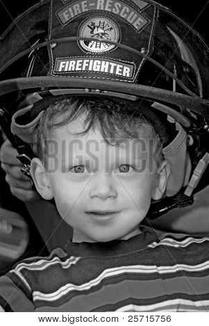 Young Boy Wearing Fireman's Hat