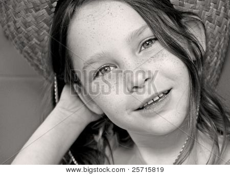 Young Freckle-Faced Girl Wearing Straw Cowboy Hat