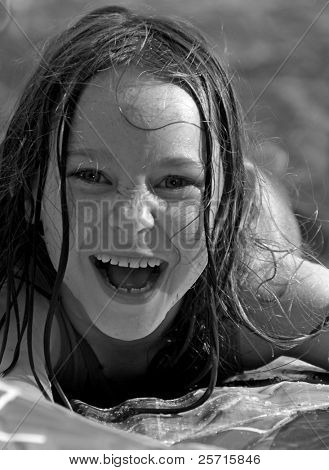 Young Girl Wet From Waterplay Having Great Time