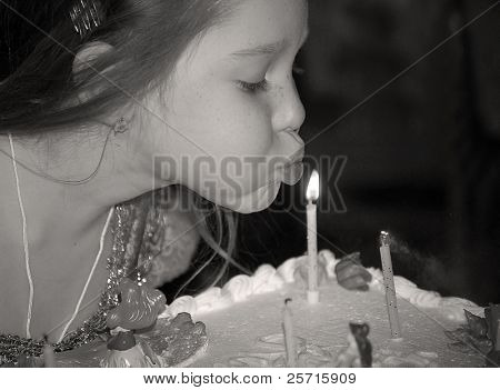 Young Girl Blowing Out Birthday Cake Candles