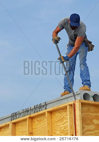 Construction Worker on Rooftop
