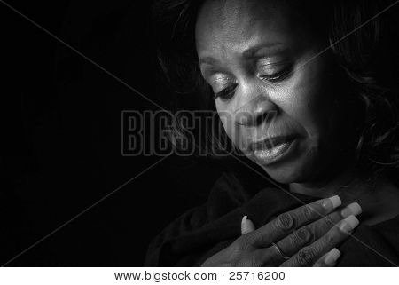 Middle Aged African American Woman Looking Down with Serious Expression