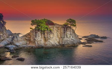 Sea Landscape At Sunrise. Beautiful View Of Cliff In Mediterranean At Dawn In Morning. Bright Red Sk