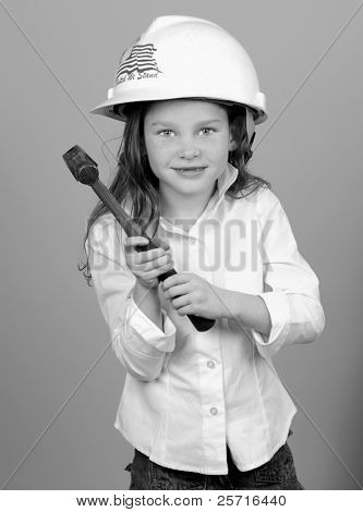 Young Girl in Hard Hat with Hammer
