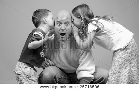 Whispered Secrets Being Told to Dad by Kids