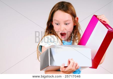Young Girl Excited While Opening Gift