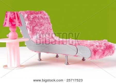 Fuzzy Lounge Chair and Pink Lamp in Green Room
