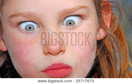 Freckle Faced Girl Making Funny Expression