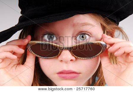 Cute Girl in Hat and Sunglasses