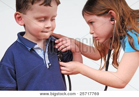 Young Children Playing Doctor with Stethoscope
