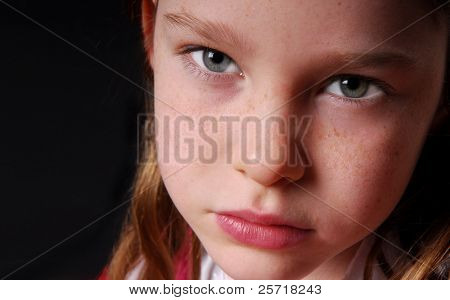 Cute young freckle faced girl looking ill or unhappy