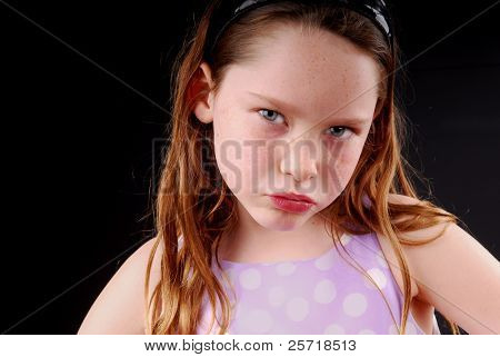 Freckle faced young girl looking irritated or upset
