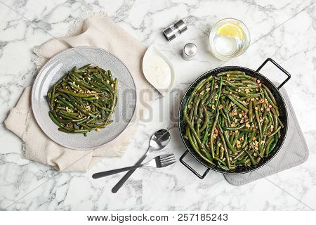 Yummy green beans with almonds served for dinner on table, flat lay poster