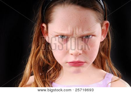 Young girl with angry or upset expression on face