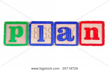 The word PLAN spelled out using antique wooden letter blocks