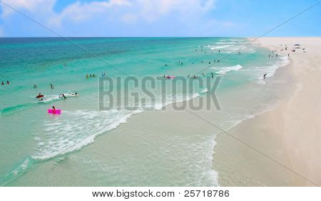 Pretty beach and ocean filled with swimming beachgoers