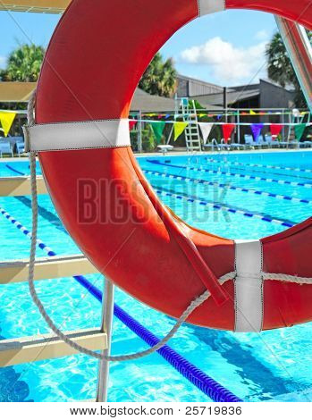 View of community swimming pool through lifeguard ring