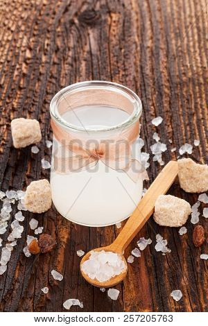 Tibi Crystal, Tibicos, Sugar Kefir Grains In Glass Jar With Sugar And Dry Fruit On Wooden Table.
