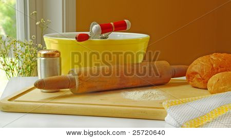 Country kitchen with bread making supplies on counter