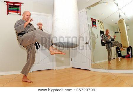 Black belt karate expert working out in dojo