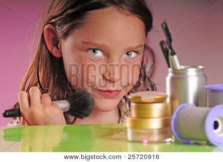 Young girl on stage set applying makeup