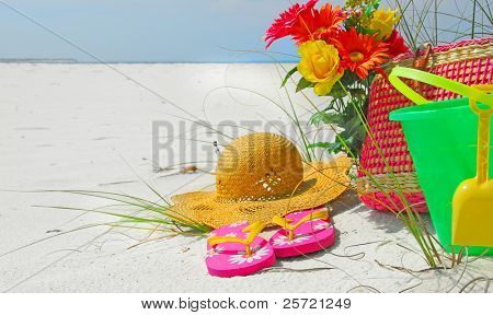 Pretty collection of beach accessories on sand