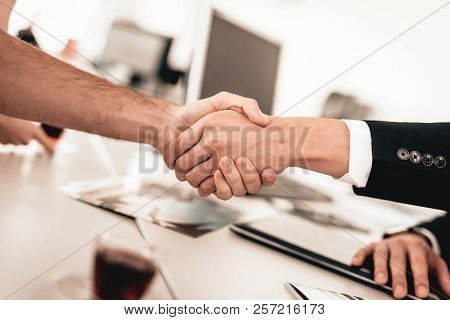 Customer And Buyer Are Shaking Each Other Hands. Automobile Salon. Make A Decision. End Of A Deal. G