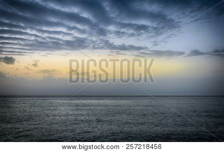 Beautiful Sunset On The Sea With Cloudy Sky