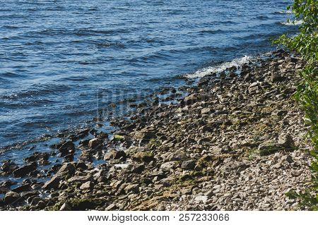 Waves Running To The Rocky Beach Shore. Desolate Place Concept