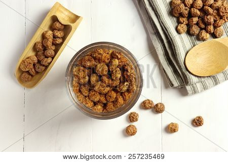 Soaking tigernuts before preparing horchata, non dairy milk typical for Valencia, top view poster