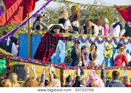 PENSACOLA, FLORIDA - FEBRUARY 13: Revelers beg for beads at the Grand Mardi Gras parade in Pensacola, Florida on February 13, 2010. Mardi Gras is a huge tourism draw celebrated here since 1874.
