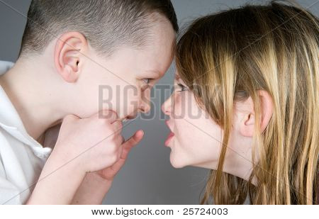 Young boy and girl bickering