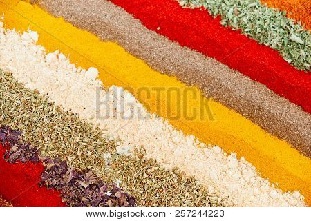 Colorful Spice Background With Different Color Spices, Macro. Various Spices Arranged In Rows. Abstr