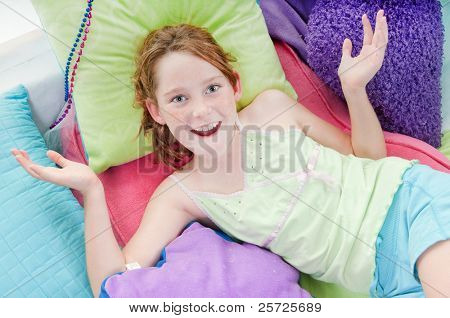 young girl looking happy while relaxing