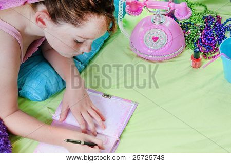 Girl writing in journal