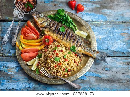 Grilled Sea Bass On Coper Plate, Moroccan Style, Copy Space