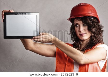 Sex Equality And Feminism. Sexy Girl Worker In Safety Helmet And Orange Vest Showing Copy Space On T
