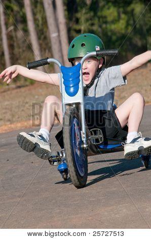 young boy having fun on trike