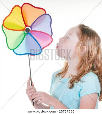 Young girl happy with wind toy