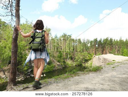 Young Woman With Backpack In Wilderness. Camping Season