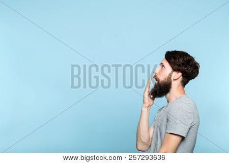 Man Looking Sideways And Is Shocked Or Impressed By Smth On The Left. Free Space For Advertisement O