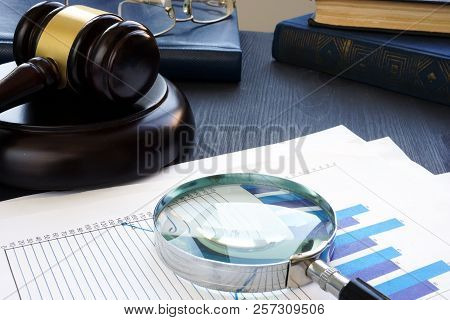Financial Crime. Gavel And Magnifying Glass With Business Documents. Fraud.
